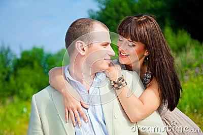 Happy enamoured couple embracing