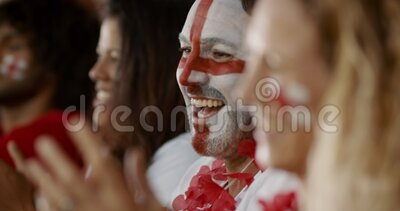 English football supporters celebrating a win. Happy English soccer supporters celebrating a win. Group of fans cheering for England team from fan zone after stock footage