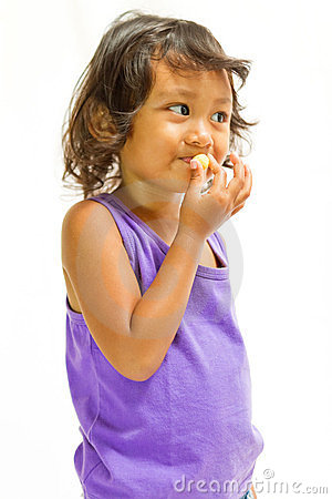Happy ethnic child enjoy eat snack
