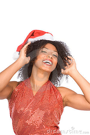 Happy excited ethnic Mrs. Claus in Christmas hat