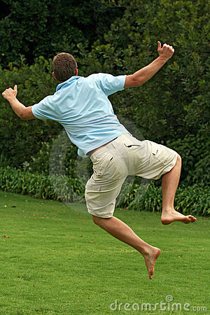 Happy, excited man, jumping in air