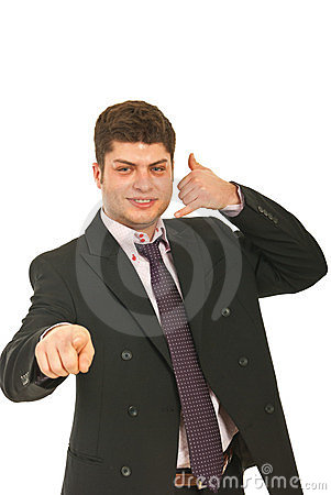 Happy executive male gesturing call me