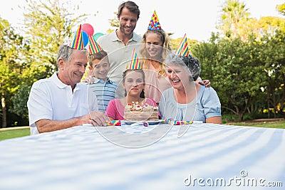 Happy extended family celebrating little girls birthday