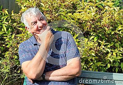 Happy facial expression elderly man.