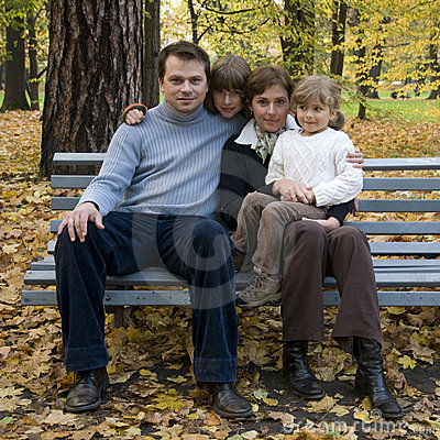 Happy family at autumn time