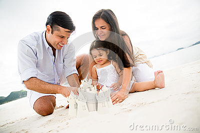 Family making sand castles