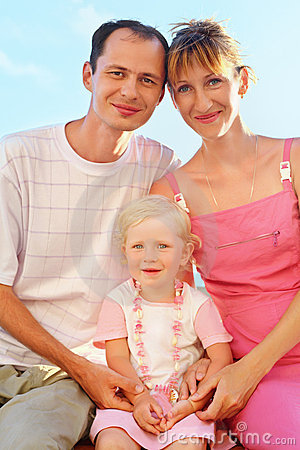 Happy family on beach, Parents hold girl for hands