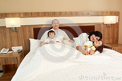 Happy family in the bed
