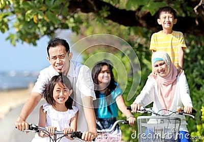 Happy family with bikes