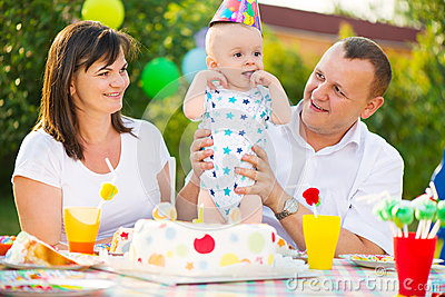 Happy family celebrating first birthday of baby