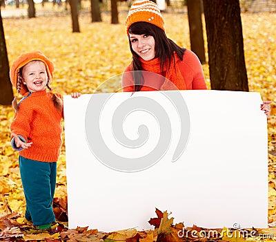 Happy family, child on autumn orange leaf, banner