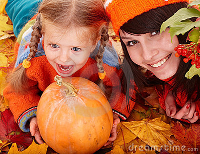 Happy family child autumn orange leaf, pumpkin