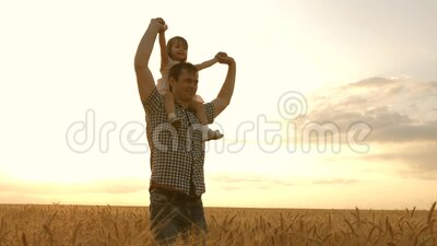 Happy family and childhood concept. little daughter on the shoulders of a farmer`s father. baby boy and dad travel on a. Happy family and childhood concept stock video footage