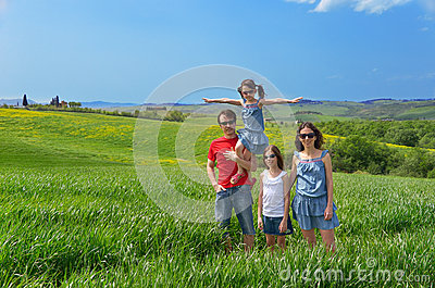 Happy family with children having fun outdoors