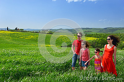 Happy family with children having fun outdoors on holiday