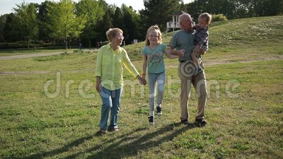Happy family with children having fun in park stock video footage