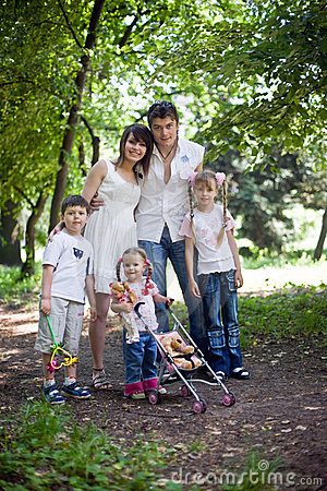 Happy family and  children in park.