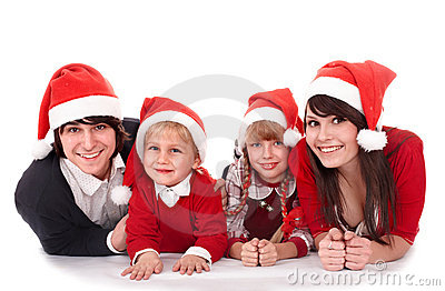 Happy family with children in santa hat.