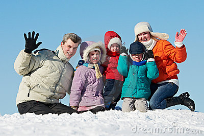Happy family with children in winter