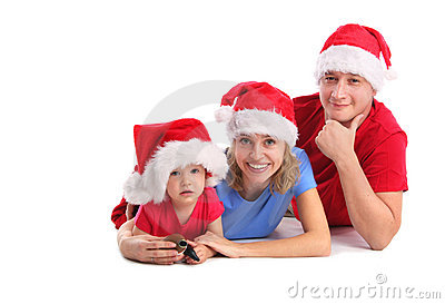 Happy family in Christmas hats