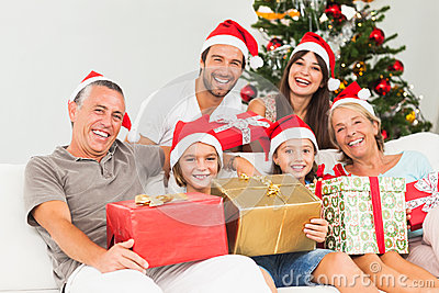 Happy family at christmas holding gifts