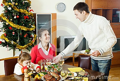 Happy family at Christmas time or winter holiday