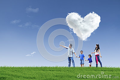 Happy family and cloud of love in park