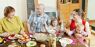 Happy  family communicate over holiday table