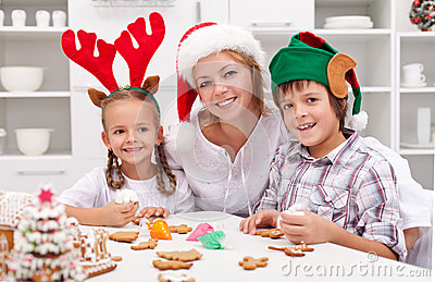 Happy family decorating christmas cookies