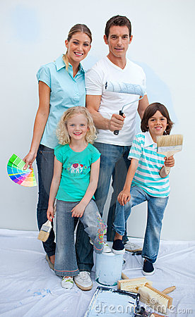 Happy family decorating their new house
