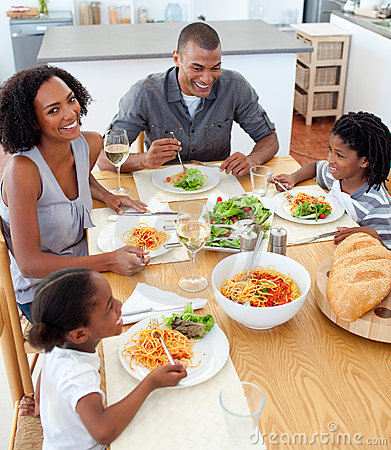 Free Happy Family Dining Together Stock Photography - 12867702