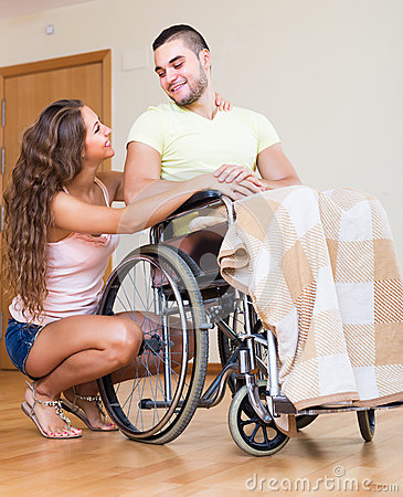 Happy family with disabled spouse Stock Photo