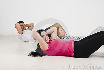 Happy family doing abs