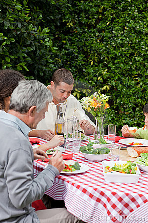 Free Happy Family Eating In The Garden Royalty Free Stock Photo - 18104575
