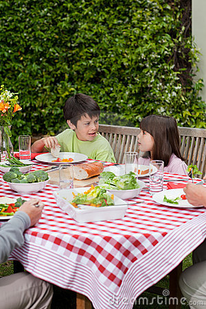 Free Happy Family Eating In The Garden Stock Image - 18104591