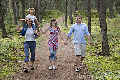 Happy family in the forest