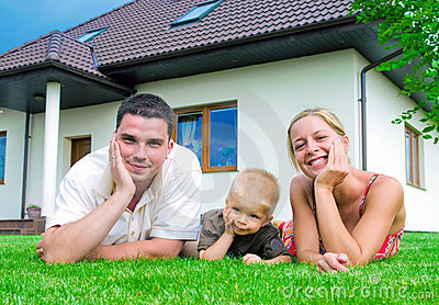 Happy family in front of the house