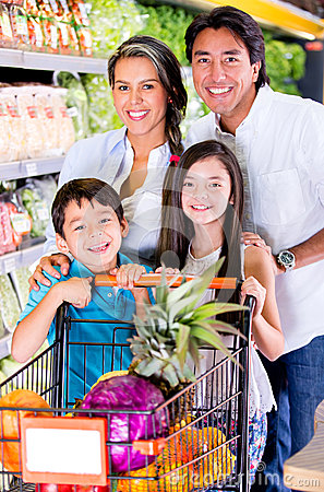Happy family at the grocery store