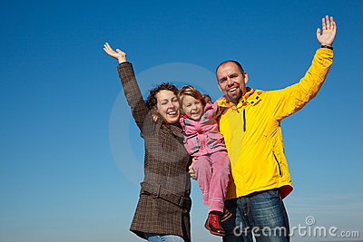 Happy family with the hands lifted upwards