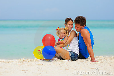 Happy family have a party on tropical beach