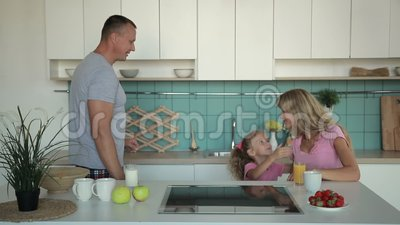 Happy family having breakfast in the morning stock footage