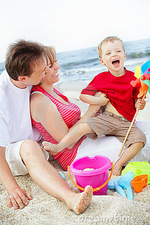 Free Happy Family Having Fun On The Beach. Royalty Free Stock Image - 12921006