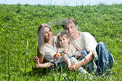 Happy family having fun outdoors in spring park
