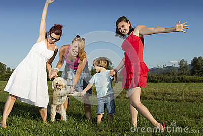 Happy family having fun outdoors on a sunny day, w
