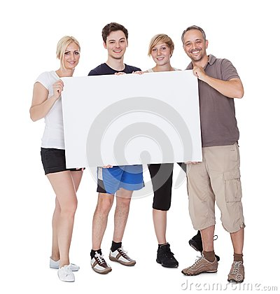 Happy family holding blank placard