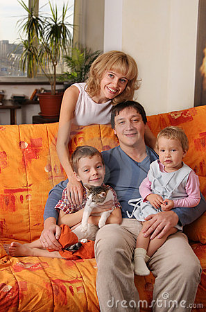 Happy family of the house on a sofa 2