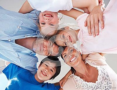 Happy family huddling together