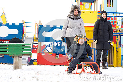 Happy family in a kids winter playground