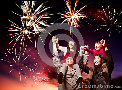 Happy  family looking fireworks