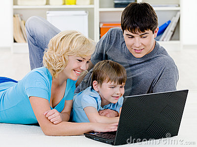 Happy family looking in laptop together